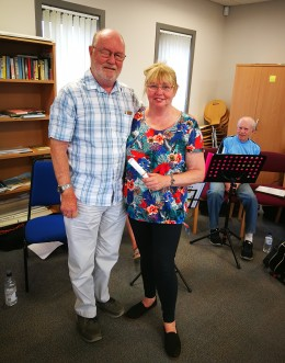 Maggie receiving her song from Denis